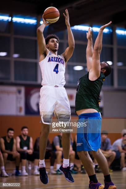 Chase Jeter of the Arizona Wildcats shoots over Pol Farres of the Mataro AllStars during the Arizona In Espana Foreign Tour game between Mataro...
