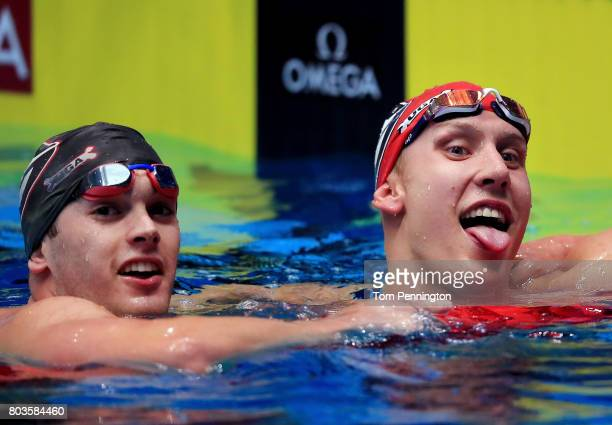 Chase Kalisz celebrates with Gunnar Bentz after winning the Men's 400 LC Meter Individual Medley Final during the 2017 Phillips 66 National...