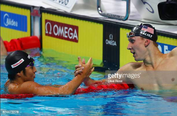 Chase Kalisz of the United States celebrates victory in the Men's 400m Individual Medley Final with Daiya Seto of Japan on day seventeen of the...