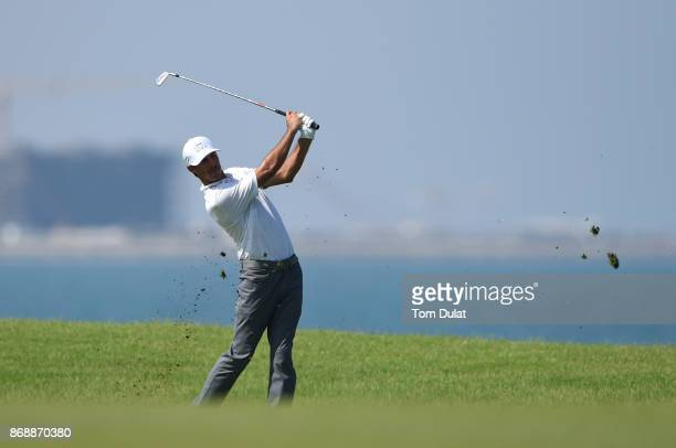 Chase Koepka of the United States hits an approach shot on the 9th hole during day one of the NBO Golf Classic Grand Final at Al Mouj Golf on...