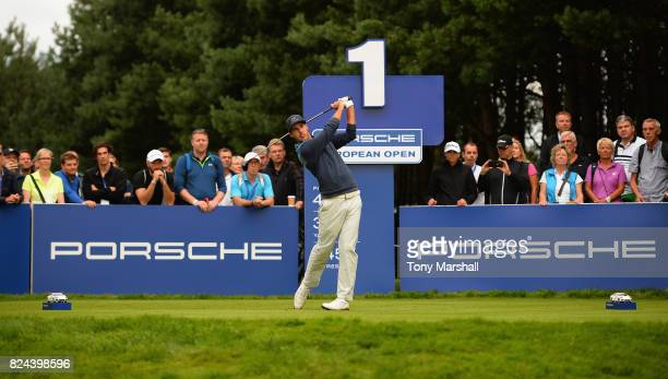 Chase Koepka of the United States plays his first shot on the 1st tee during the Porsche European Open Day Four at Green Eagle Golf Course on July 30...