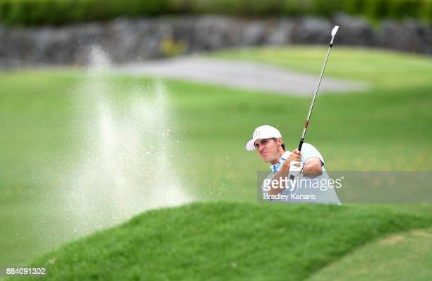Chase Koepka of the USA plays a shot on the 13th hole during day three of the 2017 Australian PGA Championship at Royal Pines Resort on December 2...