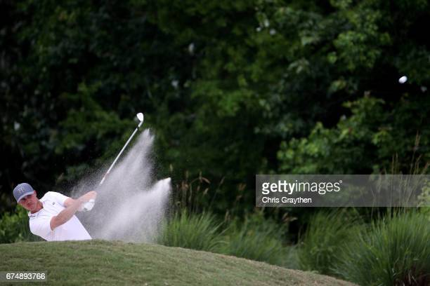 Chase Koepka plays his shot out of the bunker on the fifth hole during the third round of the Zurich Classic at TPC Louisiana on April 29 2017 in...