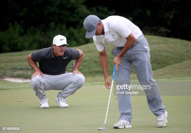 Chase Koepka putts as Brooks Koepka looks on during the third round of the Zurich Classic at TPC Louisiana on April 29 2017 in Avondale Louisiana