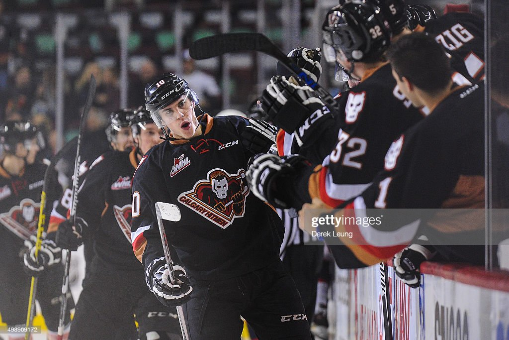 Chase Lang #10 of the Calgary Hitmen celebrates with the bench after scoring against the Regina Pats during a WHL game at Scotiabank Saddledome on November 27, 2015 in Calgary, Alberta, Canada.