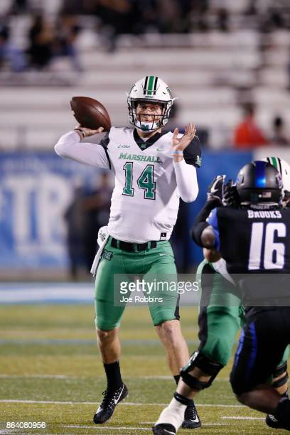 Chase Litton of the Marshall Thundering Herd throws a pass in the first quarter of a game against the Middle Tennessee Blue Raiders at Floyd Stadium...