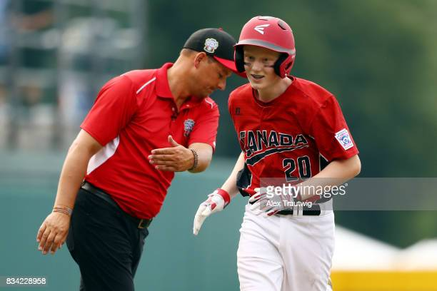Chase Marshall of the Canada team from British Columbia rounds the bases after hitting a home run during Game 3 of the 2017 Little League World...