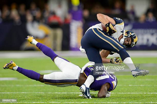 Chase Reynolds of the Los Angeles Rams avoids a tackle by Mackensie Alexander of the Minnesota Vikings during the game on September 1 2016 at US Bank...