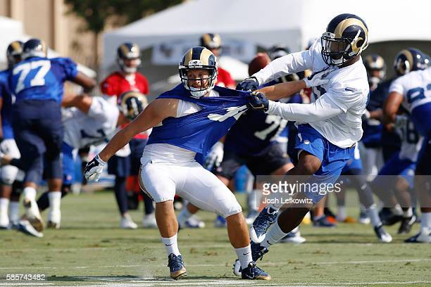 Chase Reynolds of the Los Angeles Rams tries to break free from Nic Grigsby during afternoon practice on August 3 2016 in Irvine California