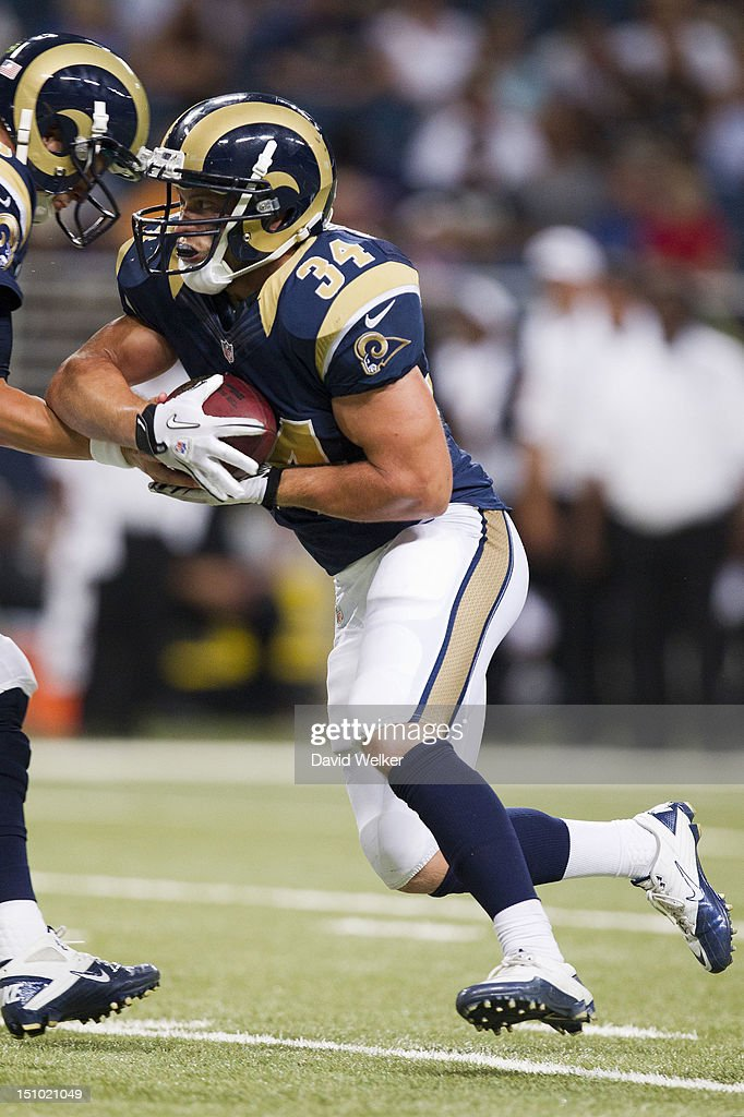 Chase Reynolds #34 of the St. Louis Rams receives a hand off during the game against the Baltimore Ravens at the Edward Jones Dome on August 30, 2012 in St. Louis, Missouri. The St. Louis Rams defeated the Baltimore Ravens 31-17.
