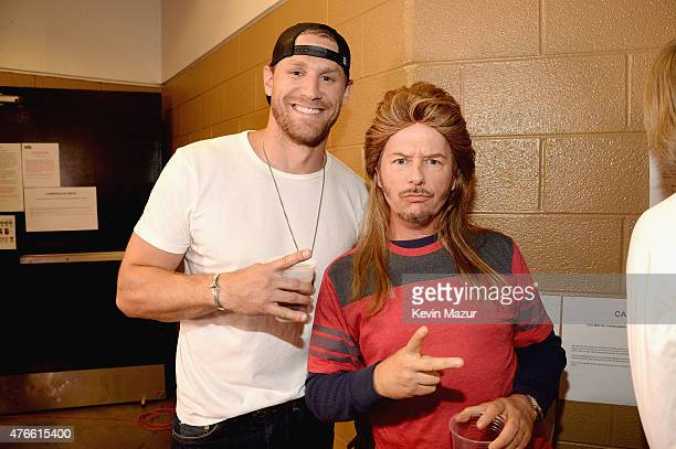 Chase Rice and David Spade attend the 2015 CMT Music awards at the Bridgestone Arena on June 10 2015 in Nashville Tennessee