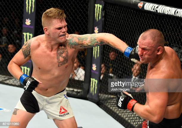 Chase Sherman punches Damian Grabowski of Poland in their heavyweight bout during the UFC Fight Night event inside the Nassau Veterans Memorial...