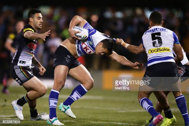 Chase Stanley of the Bulldogs is tackled during the round 21 NRL match between the Penrith Panthers and the Canterbury Bulldogs at Pepper Stadium on...