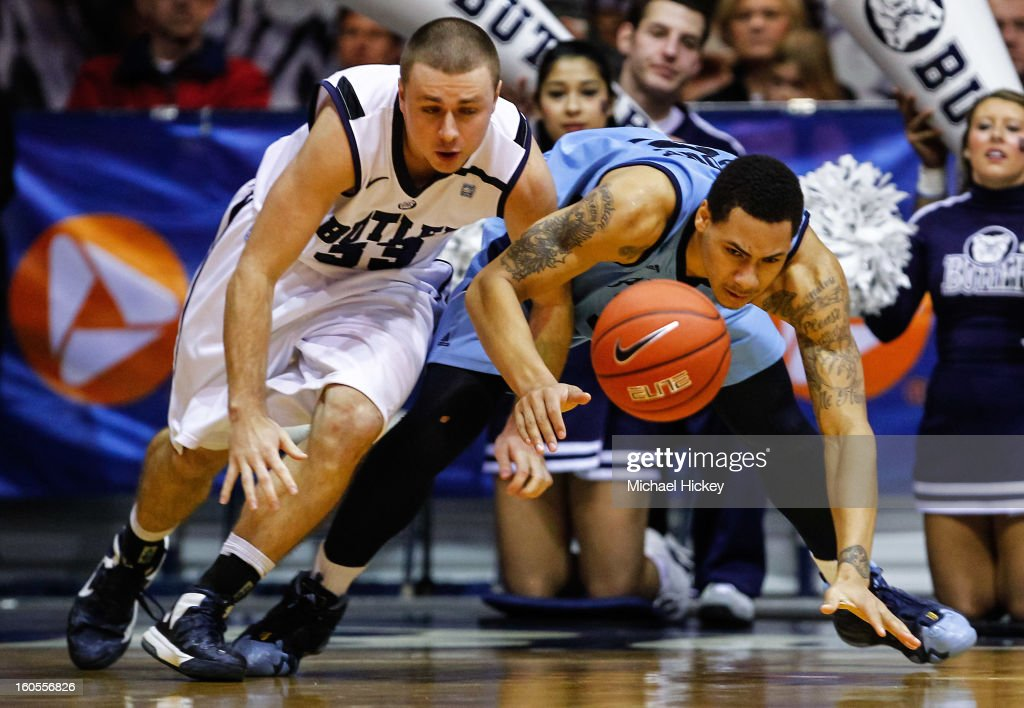 Chase Stigall #33 of the Butler Bulldogs and Andre Malone #12 of the Rhode Island Rams battle for a loose ball at Hinkle Fieldhouse on February 2, 2013 in Indianapolis, Indiana. Butler defeated Rhode Island 75-68.