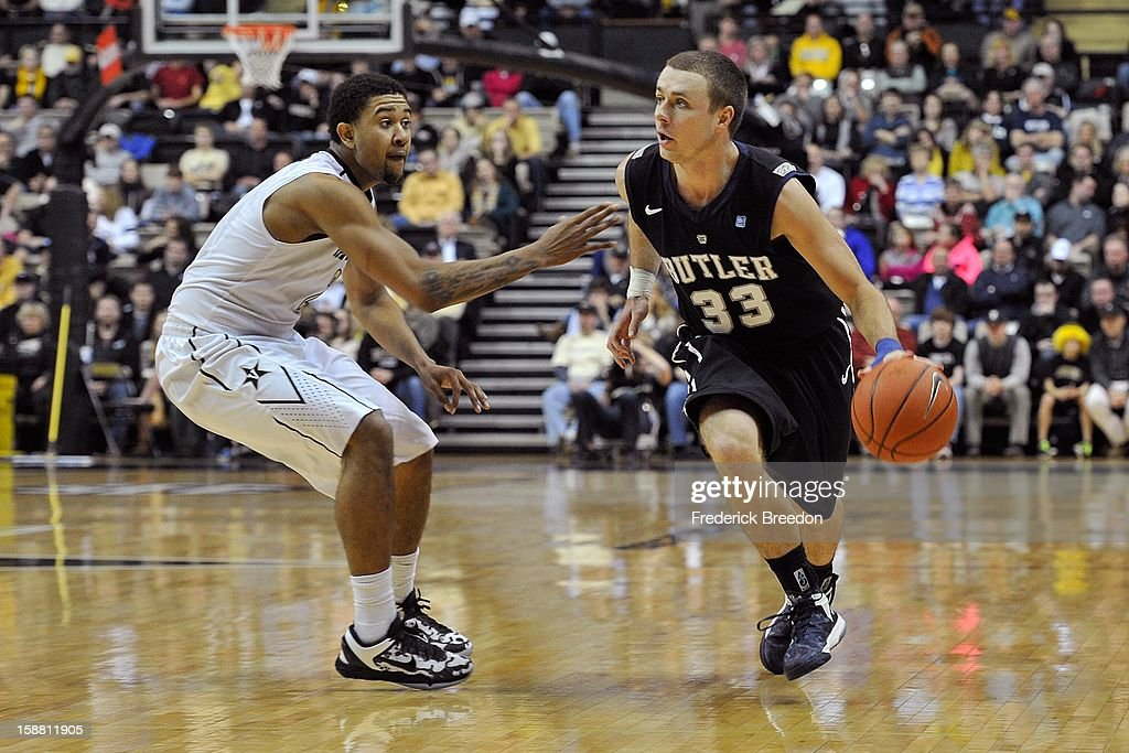 Chase Stigall #33 of the Butler Bulldogs plays against Kedren Johnson #2 of the Vanderbilt Commodores at Memorial Gym on December 29, 2012 in Nashville, Tennessee.
