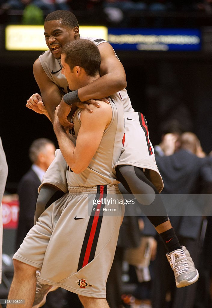 SAN DIEGO, CA - DECEMBER 15 - Chase Tapley #22 of the San Diego State Aztecs jumps in celebration onto theback of teammate James Rahon #11 in the second half of the game against the University of San Diego Tereros at Viejas Arena on December 15, 2012 in San Diego, California.