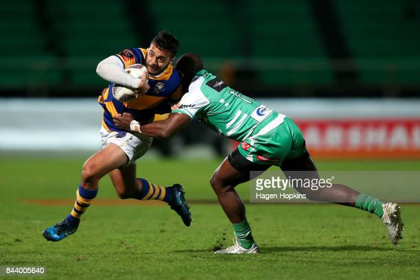 Chase Tiatia of Bay of Plenty is tackled by Willy Ambaka of Manawatu during the round four Mitre 10 Cup match between Manawatu and Bay of Plenty at...