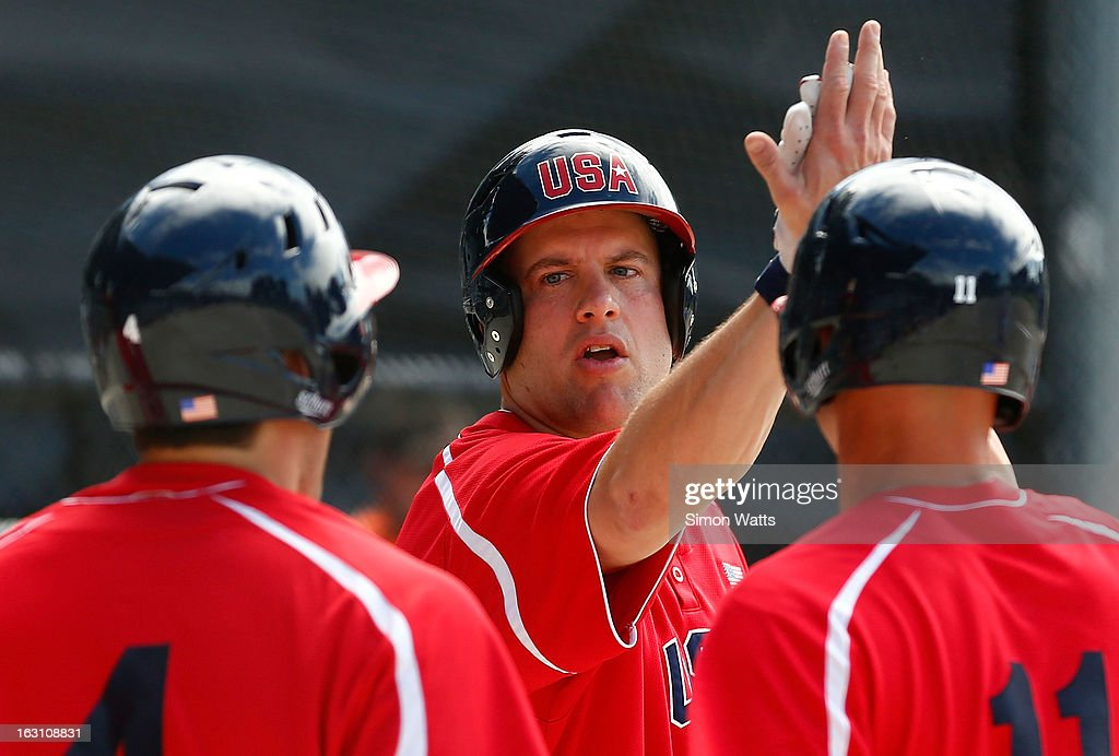 Chase Turner of the USA celebrates a home run during the pool A match between Indonesia and the USA at Tradstaff Sports Stadium on March 5, 2013 in Auckland, New Zealand.