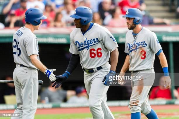 Chase Utley celebrates with Chris Taylor of the Los Angeles Dodgers and Yasiel Puig Taylor and Puig score during the second inning against the...