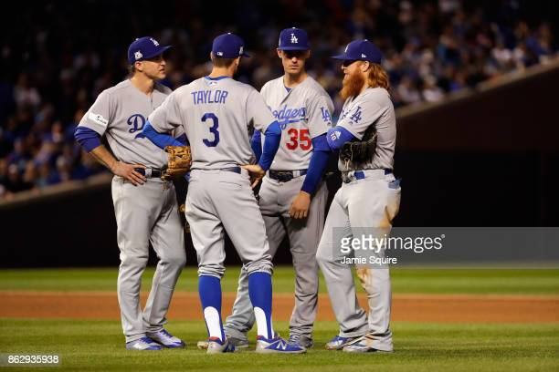 Chase Utley Chris Taylor Cody Bellinger and Justin Turner of the Los Angeles Dodgers meet during a pitching change in the sixth inning against the...