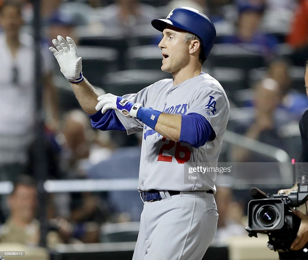 Chase Utley #26 of the Los Angeles Dodgers celebrates his grand slam in the seventh inning against the New York Mets at Citi Field on May 28, 2016 in the Flushing neighborhood of the Queens borough of New York City.