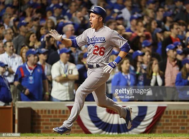 Chase Utley of the Los Angeles Dodgers celebrates scoring a run on a tworun RBI single hit by Adrian Gonzalez in the eighth inning against the...