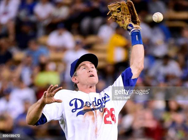 Chase Utley of the Los Angeles Dodgers drops a pop fly off the bat of TJ Rivera of the New York Mets for an error during the fourth inning at Dodger...