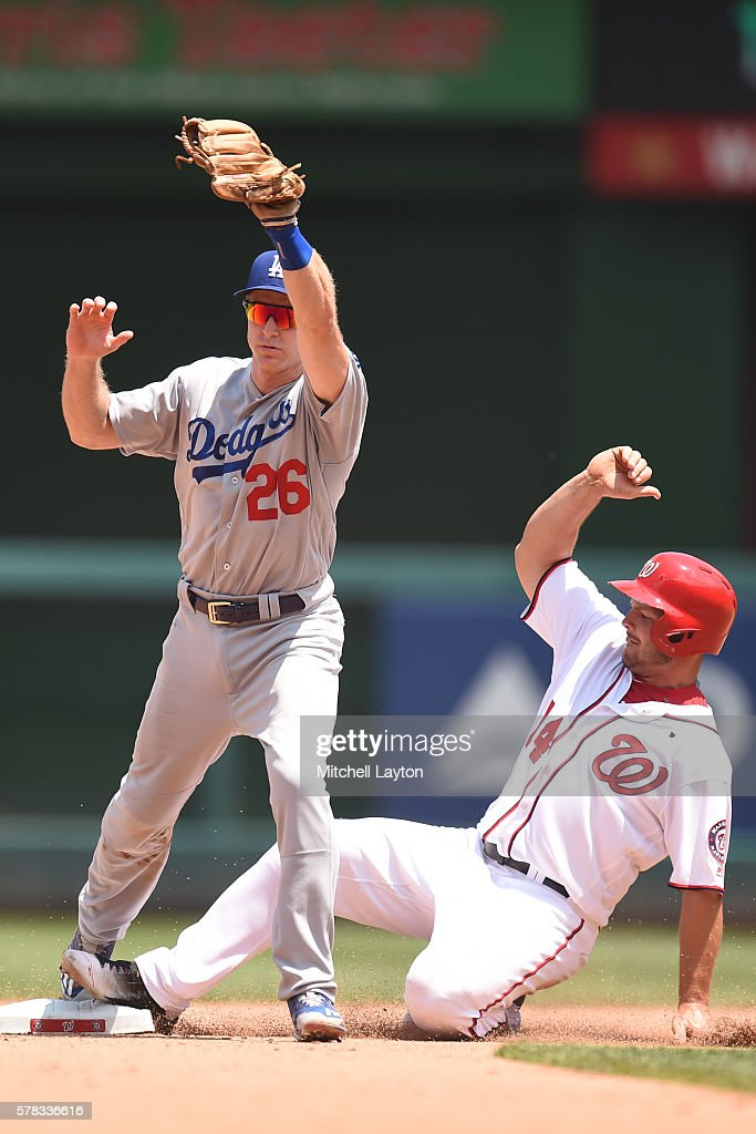 Chase Utley of the Los Angeles Dodgers force out Chris Heisey of the Washington Nationals in the fifth inning during a baseball game at Nationals...