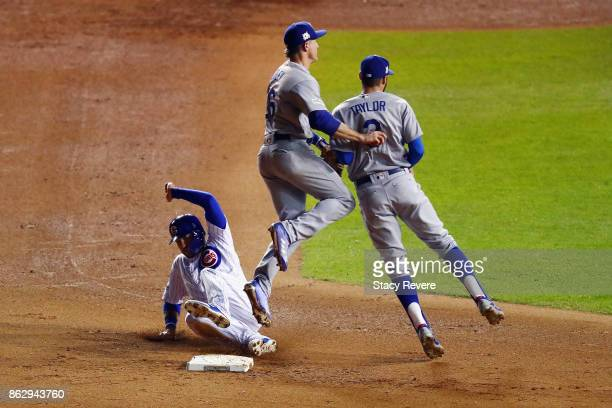 Chase Utley of the Los Angeles Dodgers forces out Albert Almora Jr #5 of the Chicago Cubs at second base next to Chris Taylor in the eighth inning...