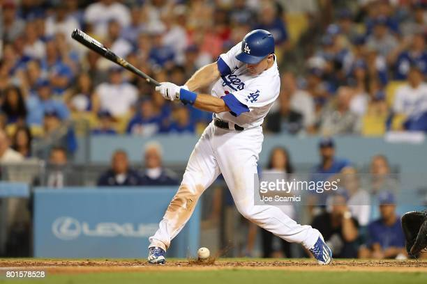Chase Utley of the Los Angeles Dodgers hits a foul ball into the ground in the 7th inning against the Los Angeles Angels at Dodger Stadium on June 26...