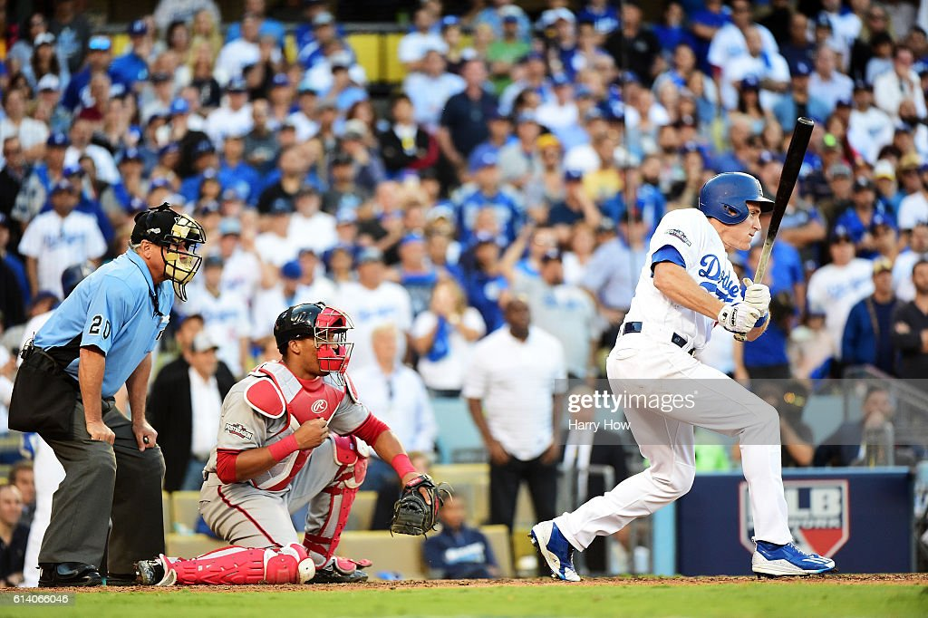 Chase Utley #26 of the Los Angeles Dodgers hits a RBI single scoring Andrew Toles #60 in the eighth inning against the Washington Nationals during game four of the National League Division Series at Dodger Stadium on October 11, 2016 in Los Angeles, California.
