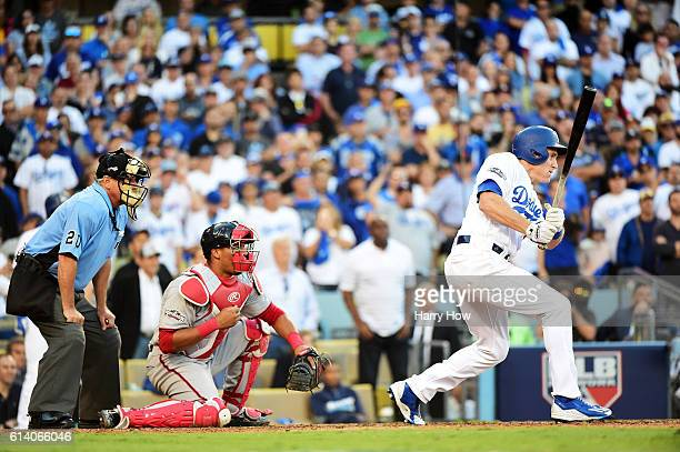 Chase Utley of the Los Angeles Dodgers hits a RBI single scoring Andrew Toles in the eighth inning against the Washington Nationals during game four...