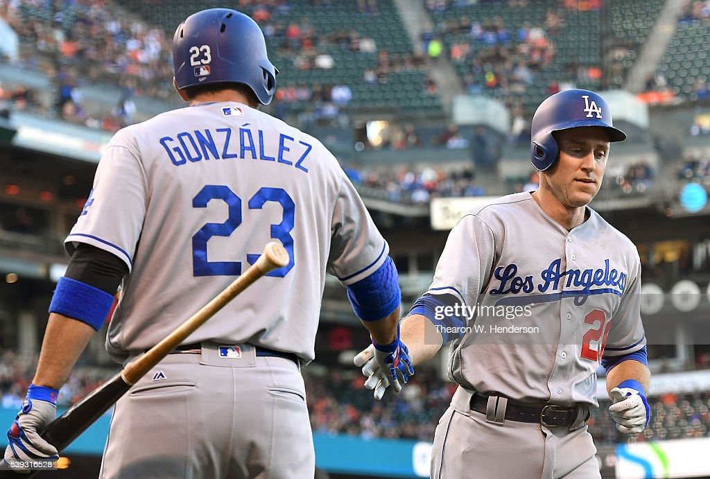 Chase Utley of the Los Angeles Dodgers is congratulated by Adrian Gonzalez after Utley scored from third on a balk called against starting pitcher...