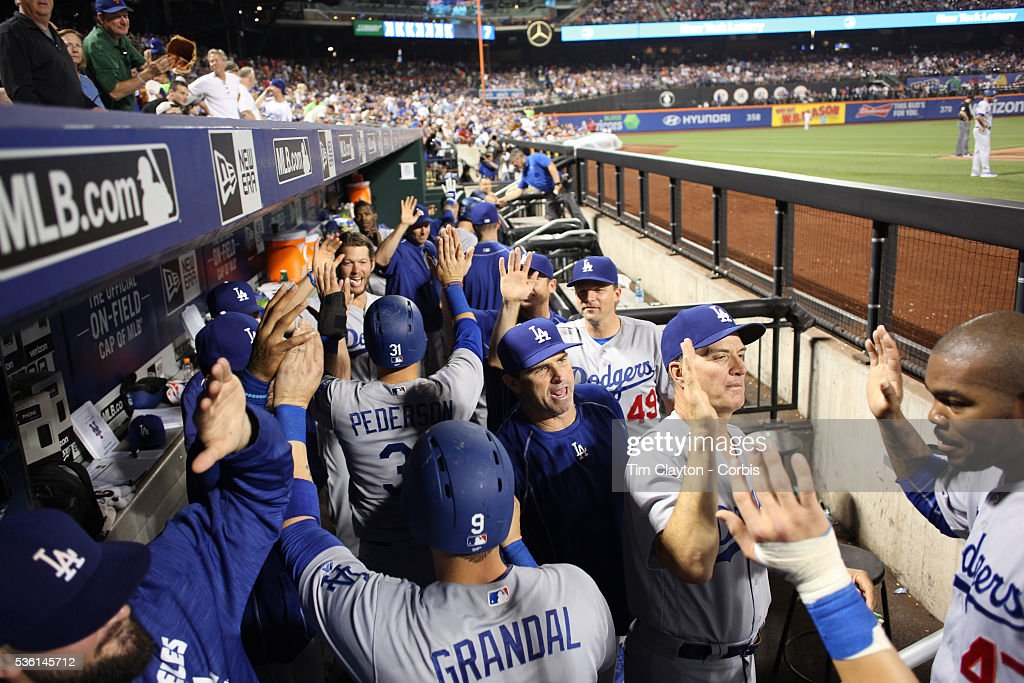 <a gi-track='captionPersonalityLinkClicked' href=/galleries/search?phrase=Chase+Utley&family=editorial&specificpeople=161391 ng-click='$event.stopPropagation()'>Chase Utley</a> #26 of the Los Angeles Dodgers is congratulated by team mates as he returns to the dugout after hitting a grand slam home run in the top of the seventh inning during the Los Angeles Dodgers Vs New York Mets regular season MLB game at Citi Field on May 28, 2016 in New York City.