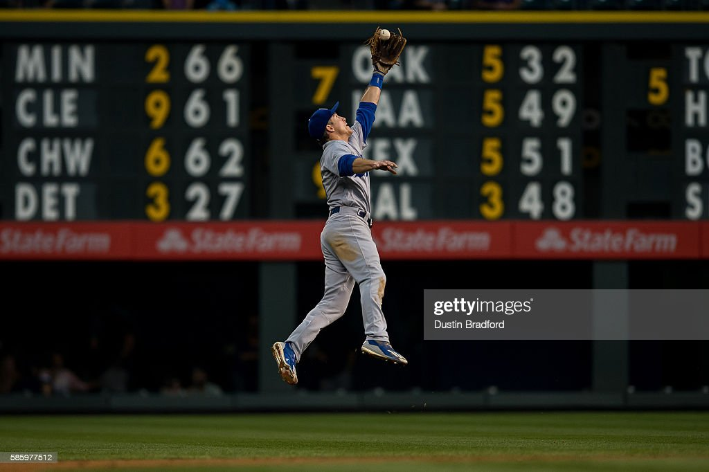 Chase Utley of the Los Angeles Dodgers makes a leaping catch to end the third inning of a game against the Colorado Rockies at Coors Field on August...