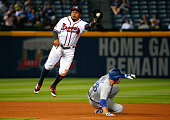Chase Utley of the Los Angeles Dodgers steals second base under Erick Aybar of the Atlanta Braves in the 10th inning at Turner Field on April 20 2016...