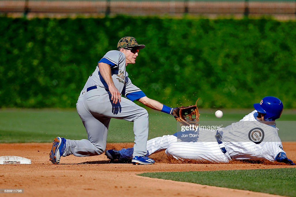 <a gi-track='captionPersonalityLinkClicked' href=/galleries/search?phrase=Chase+Utley&family=editorial&specificpeople=161391 ng-click='$event.stopPropagation()'>Chase Utley</a> #26 of the Los Angeles Dodgers tags out <a gi-track='captionPersonalityLinkClicked' href=/galleries/search?phrase=David+Ross&family=editorial&specificpeople=210843 ng-click='$event.stopPropagation()'>David Ross</a> #3 of the Chicago Cubs as he attempts to steal second base during the fourth inning at Wrigley Field on May 30, 2016 in Chicago, Illinois.