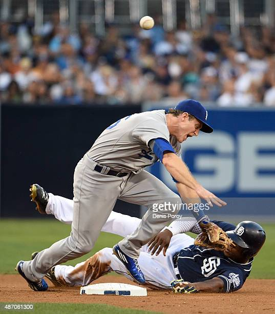 Chase Utley of the Los Angeles Dodgers throws over Justin Upton of the San Diego Padres as he slides into second base during the fourth inning of a...