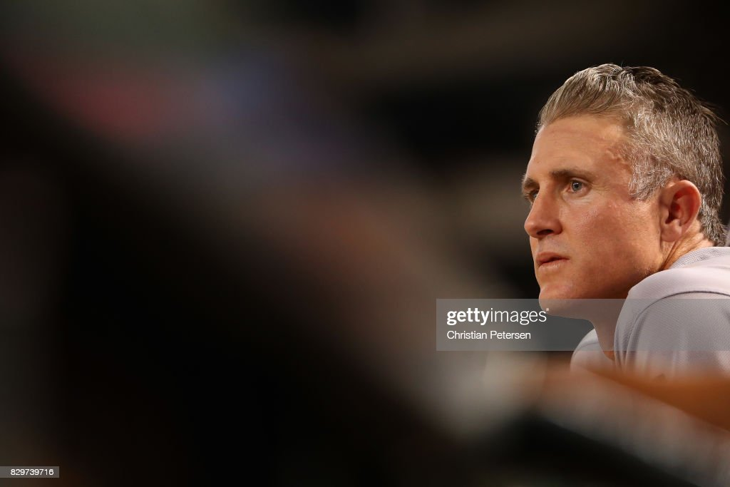 Chase Utley #26 of the Los Angeles Dodgers watches from the dugout during the MLB game against the Arizona Diamondbacks at Chase Field on August 9, 2017 in Phoenix, Arizona.