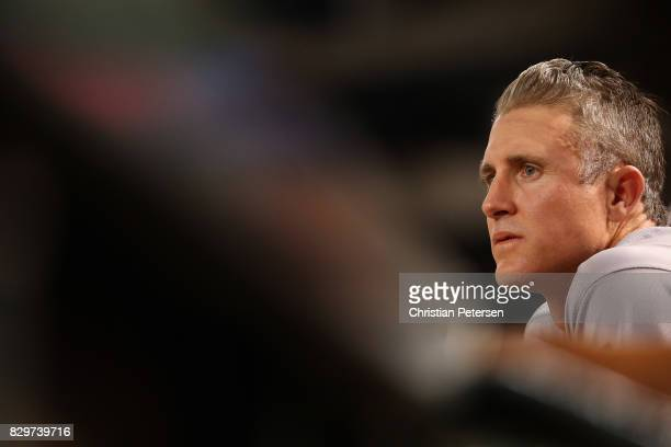 Chase Utley of the Los Angeles Dodgers watches from the dugout during the MLB game against the Arizona Diamondbacks at Chase Field on August 9 2017...