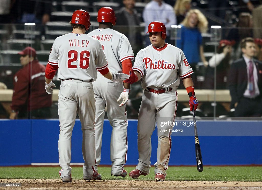 <a gi-track='captionPersonalityLinkClicked' href=/galleries/search?phrase=Chase+Utley&family=editorial&specificpeople=161391 ng-click='$event.stopPropagation()'>Chase Utley</a> #26 of the Philadelphia Phillies and Carlos Ruiz #51 celebrate with <a gi-track='captionPersonalityLinkClicked' href=/galleries/search?phrase=Ryan+Howard&family=editorial&specificpeople=551402 ng-click='$event.stopPropagation()'>Ryan Howard</a> #6 after his two run home run in the ninth inning against the New York Mets at Citi Field on September 19, 2012 in the Flushing neighborhood of the Queens borough of New York City.