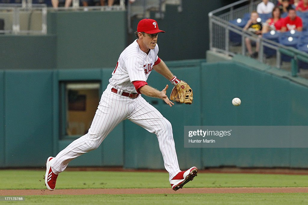 Chase Utley #26 of the Philadelphia Phillies bare hands a ground ball during a game against the Colorado Rockies at Citizens Bank Park on August 21, 2013 in Philadelphia, Pennsylvania.