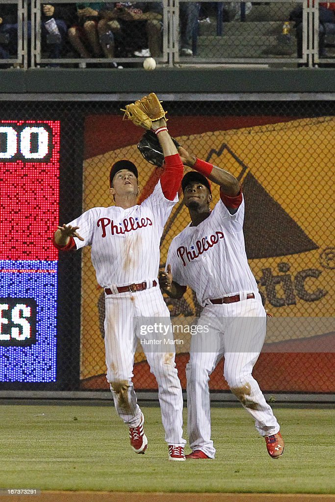 <a gi-track='captionPersonalityLinkClicked' href=/galleries/search?phrase=Chase+Utley&family=editorial&specificpeople=161391 ng-click='$event.stopPropagation()'>Chase Utley</a> #26 of the Philadelphia Phillies catches a fly ball in the seventh inning as <a gi-track='captionPersonalityLinkClicked' href=/galleries/search?phrase=John+Mayberry+Jr.&family=editorial&specificpeople=4959058 ng-click='$event.stopPropagation()'>John Mayberry Jr.</a> #15 backs him up during a game against the Pittsburgh Pirates at Citizens Bank Park on April 24, 2013 in Philadelphia, Pennsylvania. The Pirates won 5-3.
