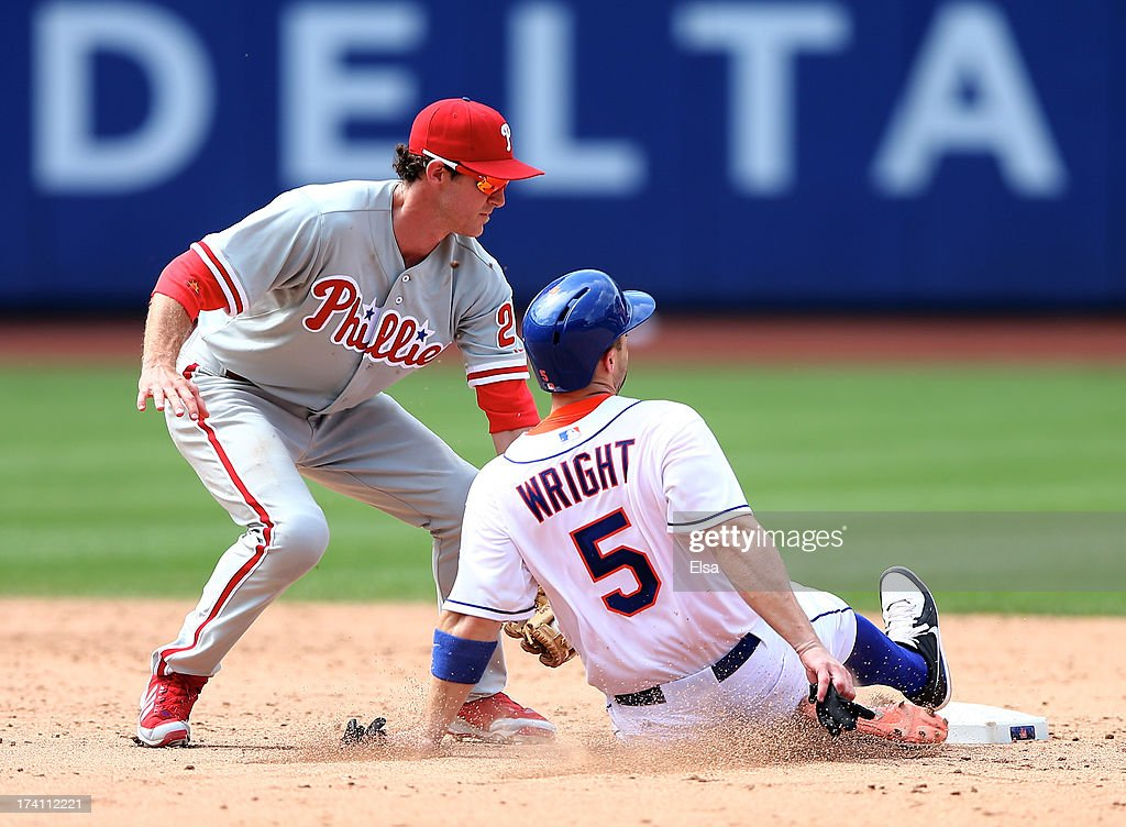 <a gi-track='captionPersonalityLinkClicked' href=/galleries/search?phrase=Chase+Utley&family=editorial&specificpeople=161391 ng-click='$event.stopPropagation()'>Chase Utley</a> #26 of the Philadelphia Phillies catches <a gi-track='captionPersonalityLinkClicked' href=/galleries/search?phrase=David+Wright+-+Baseball+Player&family=editorial&specificpeople=209172 ng-click='$event.stopPropagation()'>David Wright</a> #5 of the New York Mets stealing on July 20, 2013 at Citi Field in the Flushing neighborhood of the Queens borough of New York City. The New York Mets defeated the Philadelphia Phillies 5-4.