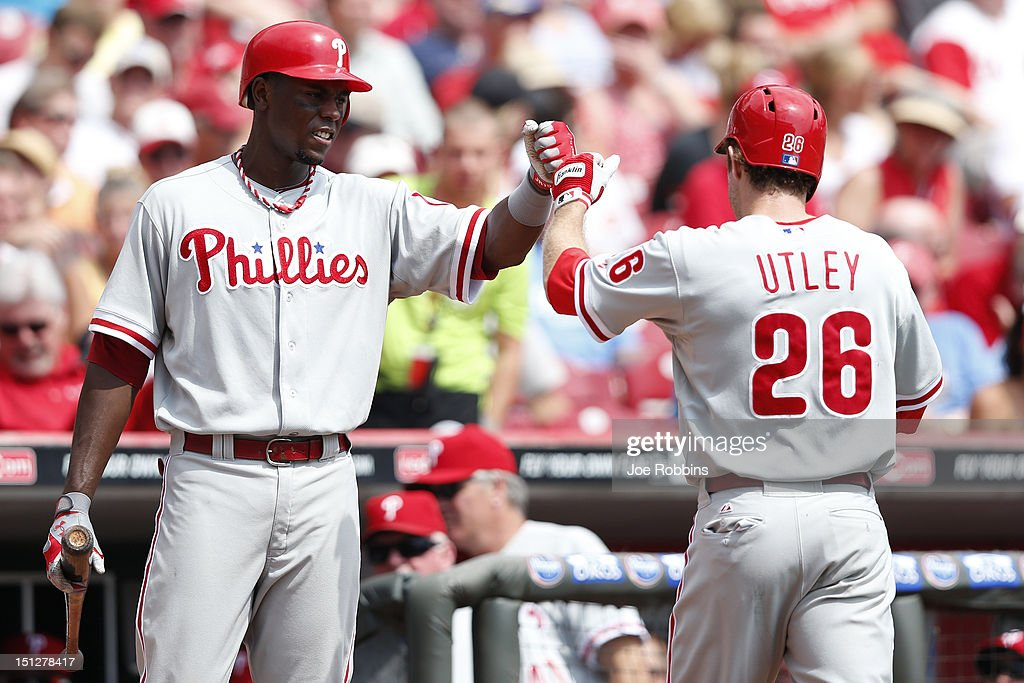 <a gi-track='captionPersonalityLinkClicked' href=/galleries/search?phrase=Chase+Utley&family=editorial&specificpeople=161391 ng-click='$event.stopPropagation()'>Chase Utley</a> #26 of the Philadelphia Phillies celebrates with <a gi-track='captionPersonalityLinkClicked' href=/galleries/search?phrase=John+Mayberry+Jr.&family=editorial&specificpeople=4959058 ng-click='$event.stopPropagation()'>John Mayberry Jr.</a> #15 after hitting a two-run home run in the second inning of the game against the Cincinnati Reds at Great American Ball Park on September 5, 2012 in Cincinnati, Ohio.