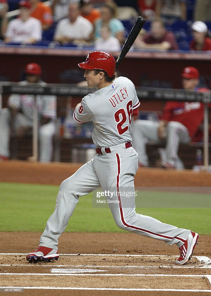 <a gi-track='captionPersonalityLinkClicked' href=/galleries/search?phrase=Chase+Utley&family=editorial&specificpeople=161391 ng-click='$event.stopPropagation()'>Chase Utley</a> #26 of the Philadelphia Phillies delivers an RBI single against the Miami Marlins during the first inning at Marlins Park on July 1, 2014 in Miami, Florida.