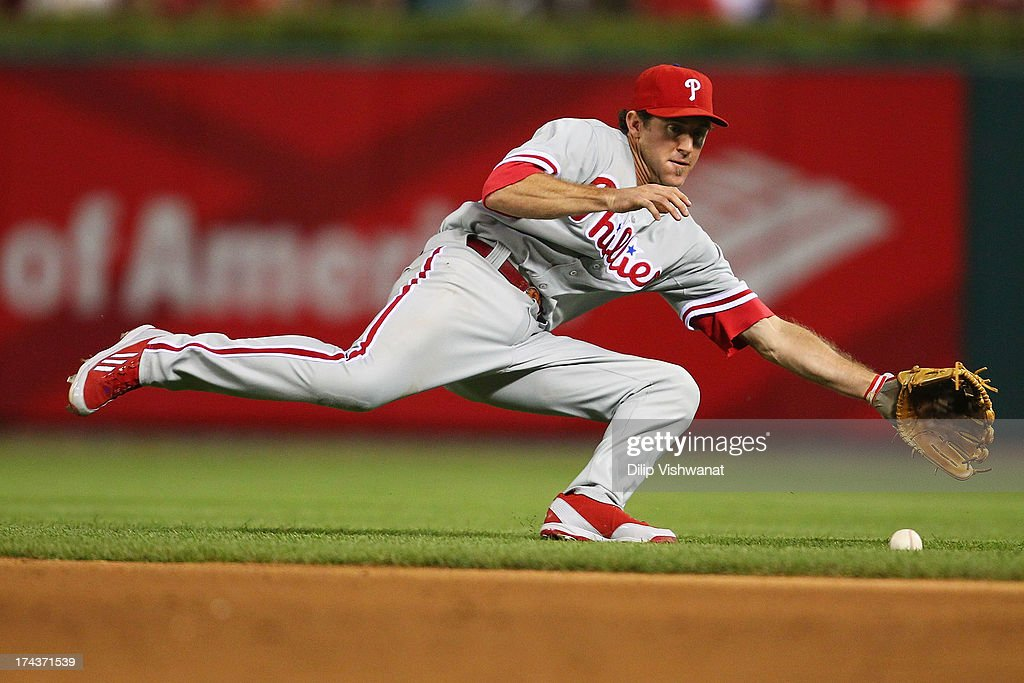 <a gi-track='captionPersonalityLinkClicked' href=/galleries/search?phrase=Chase+Utley&family=editorial&specificpeople=161391 ng-click='$event.stopPropagation()'>Chase Utley</a> #26 of the Philadelphia Phillies fields a ground ball against the St. Louis Cardinals in the seventh inning at Busch Stadium on July 24, 2013 in St. Louis, Missouri. The Cardinals beat the Phillies 11-3.
