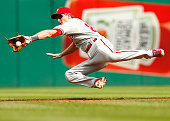 Chase Utley of the Philadelphia Phillies fields a ground ball while midair in the second inning against the Pittsburgh Pirates during the game at PNC...