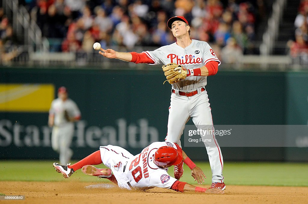 Chase Utley #26 of the Philadelphia Phillies forces out Ian Desmond #20 of the Washington Nationals to start a double play in the seventh inning at Nationals Park on April 16, 2015 in Washington, DC.