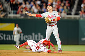 Chase Utley of the Philadelphia Phillies forces out Ian Desmond of the Washington Nationals to start a double play in the seventh inning at Nationals...